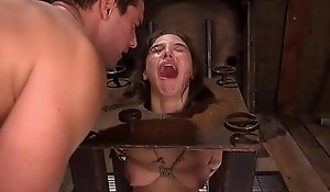 Pegged s&m sub boxed in advance of electrosex