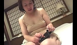 Oriental granny inserts a sex tool far her bawdy crevice